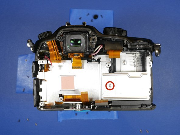Remove the one screw holding in the aluminum heatsink to the remainder of the camera.