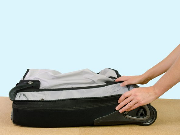 Open the main compartment of your bag until it lays flat on the table.