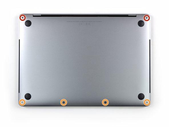 Avant de continuer, débranchez et éteignez votre MacBook. Fermez l'écran et posez-le à l'envers sur une surface douce.