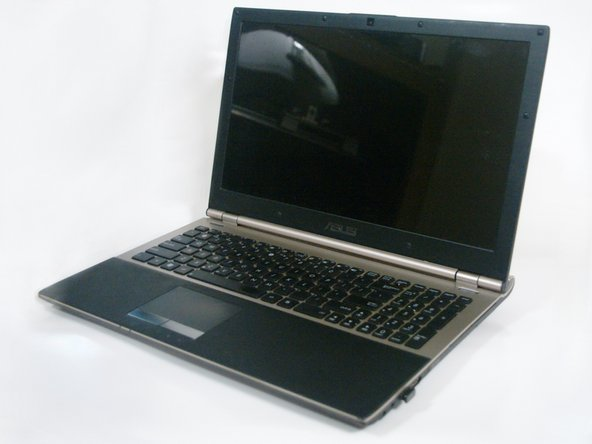 Position the laptop on a flat, stable surface, with the underside facing upward.