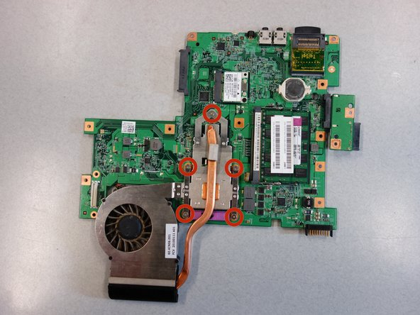 Flip the motherboard over to reveal the fan.