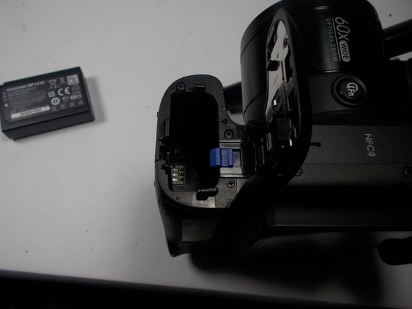 Carefully slide the battery out of the camera. It can then be replaced with a new battery.