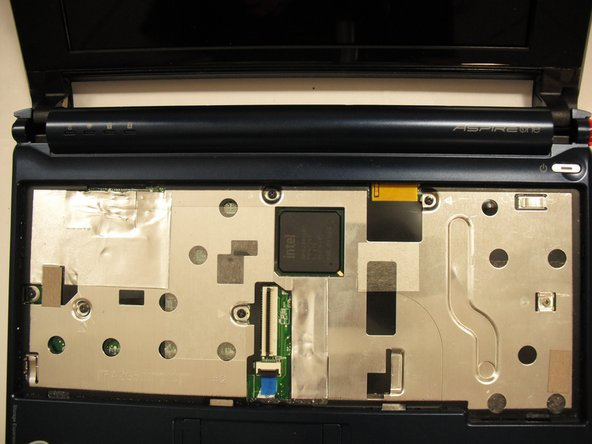 Turn the netbook back over and open the display with the keyboard cavity facing you.
