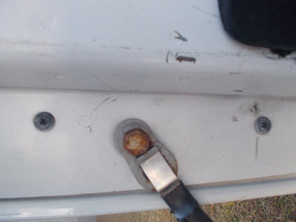 Unscrew the two phillips head screws located above and below the tailgate support.