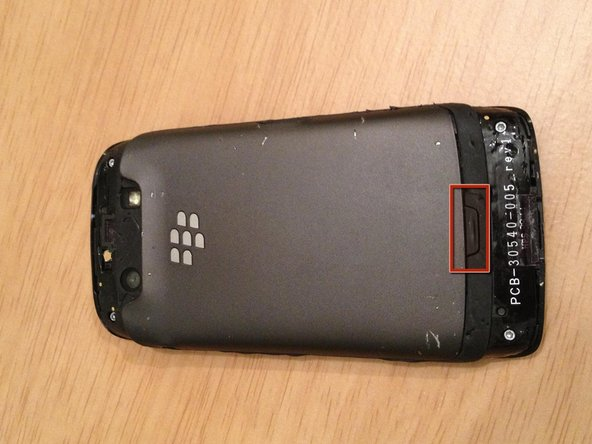 Depress the battery cover release button and remove the battery cover