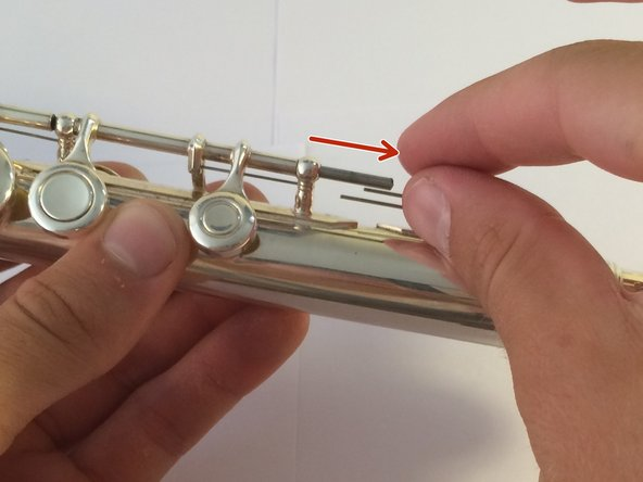 Next, loosen the screw connected to the C, B flat, and A keys. This screw is actually a rod. Pull this rod out using your fingers.