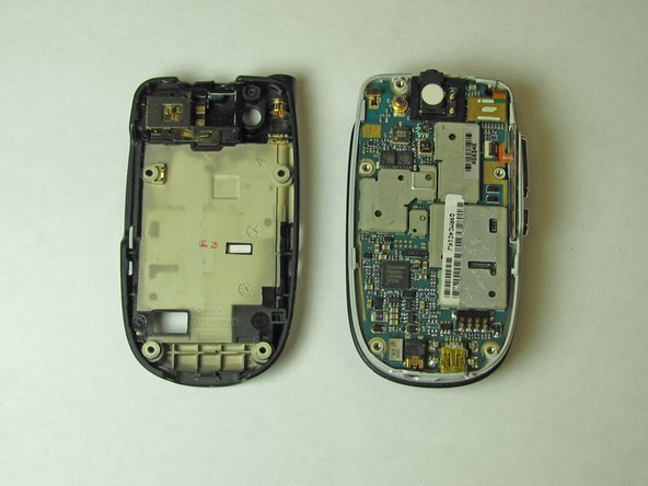 Note: The logic board may initially seem glued to the phone. It is not glued but does require input of force to remove.
