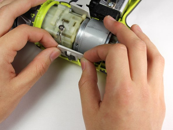 Lift the gear switch upwards from the top of the drill head.