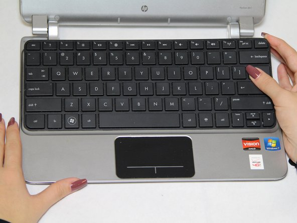 Flip the laptop so that they keyboard is facing you.