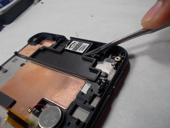Remove top speaker gently with a pair of tweezers.