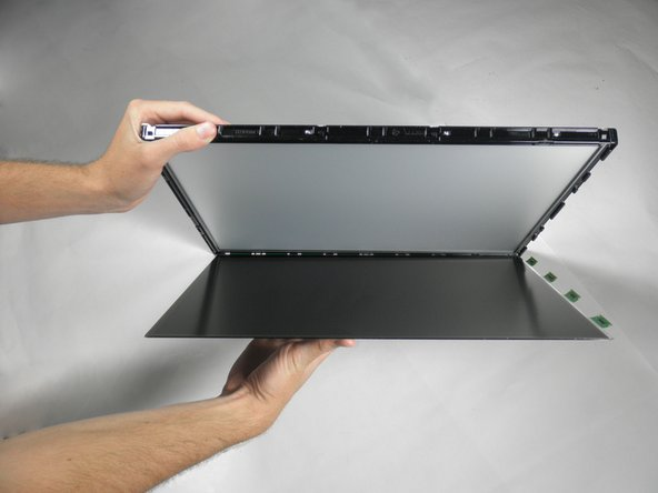 Image 1/1: The circuit board will still be connected to the metal casing. Do not rip out the screen to avoid damage to the board.