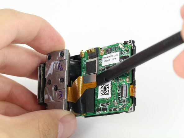 Remove the silver connector of the image sensor from the motherboard using the spudger to pry it off.