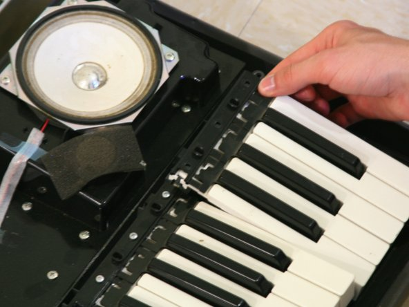 Image 1/1: To do this, apply a small force away from the top of the keys and slightly toward the floor.