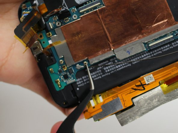 Image 3/3: Use a pair of tweezers to disconnect the two antenna cables.