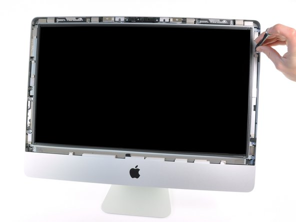 The LED-backlit glossy widescreen display is secured to the front bezel by several T10 Torx screws.