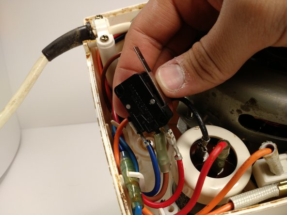 Pull off the three wires on the safety switch with your hand by firmly grabbing the wires at the base.