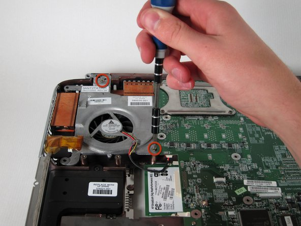 Unscrew and remove the two 8mm Philips screws from the heat sink fan.