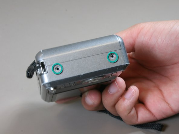 Using a #00 screw driver, remove the two screws on the bottom of the camera.