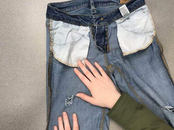 Turn the jeans inside out.