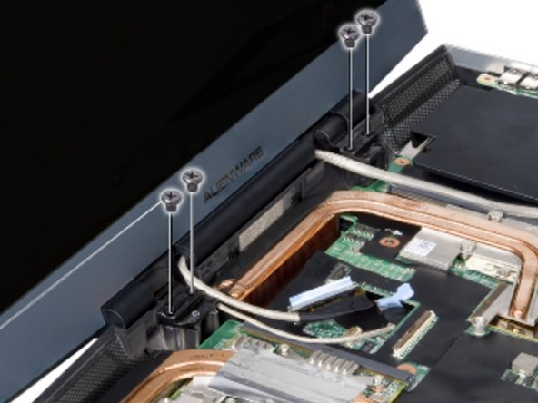 Align the screw holes on the display hinges with the computer base.