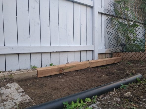 Use a rake to make the soil more leveled out to the surface.