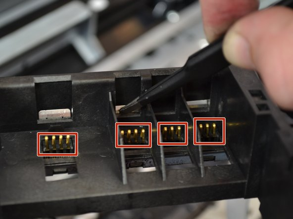The four (4) connectors should come out easily. If they do not, you can use tweezers to push them out from the top.