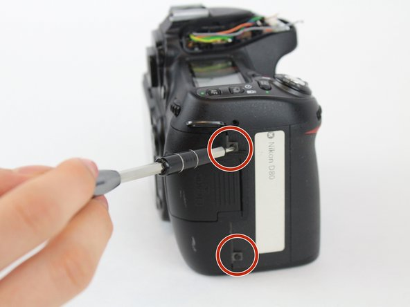 Using a  Phillips #00  screwdriver, remove the four 6.2 mm screws from the left and right sides of the outer cover.