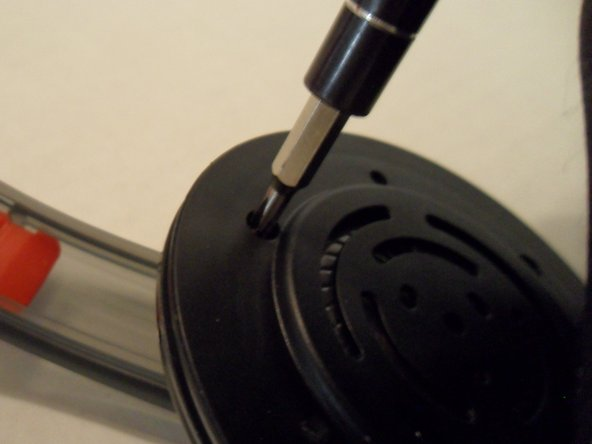 Use a Phillips #0 to unscrew three 3.4MM screws from the earpiece.