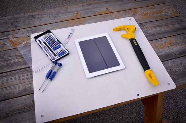 Stanley iPad opening tool next to iPad