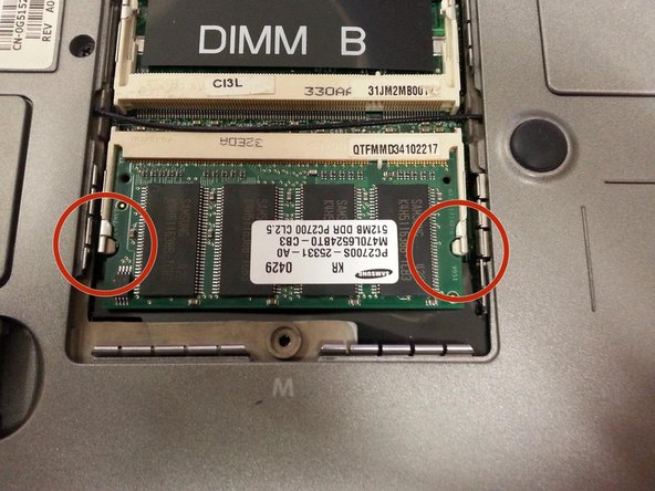 RAM is held in by two tabs, pull each tab to the side and the RAM will pop up