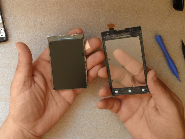 Clear the touchscreen from the old adhesive tape.