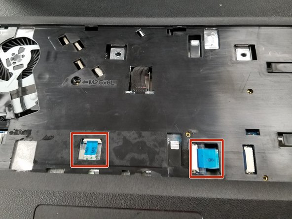 Pull the two connectors with blue ribbons marked with MB in the opposite direction of the connector