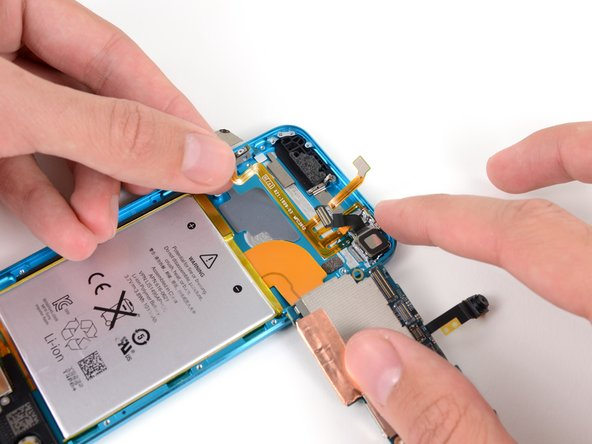 Image 1/3: The rear-facing camera is easily removed from the entire ribbon cable assembly.