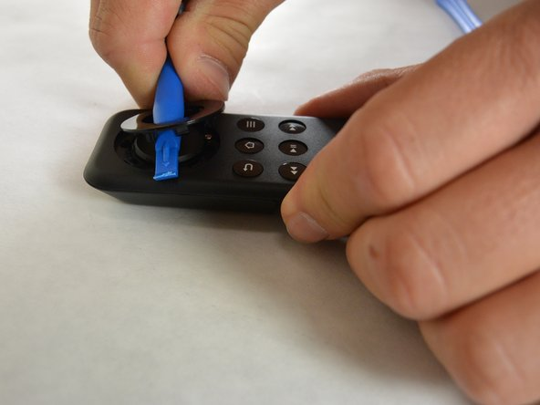 To remove the buttons use the blue plastic opening tool to pry out the outer ring.