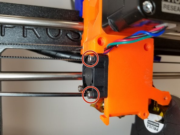 Remove the two M3 Bolts that are holding on the Extruder Cooling Fan.