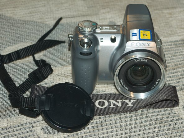 It's a 6.0mpix, 12x optical zoom compact digital camera.
