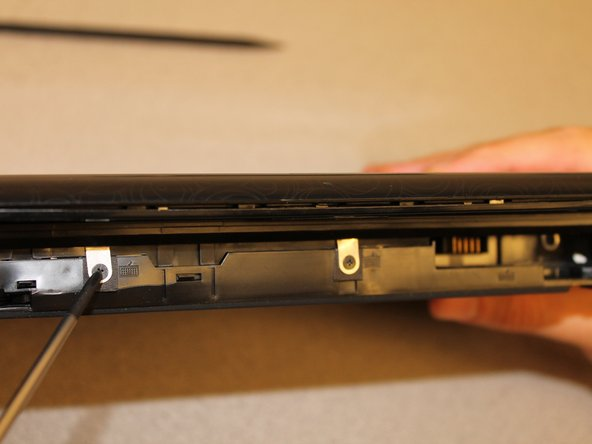 Remove the three 2.9mm screws in the battery slot.