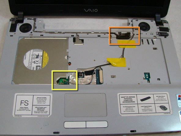 Once the new screen and its cables are securely in place, attach the three cables to their corresponding ports.