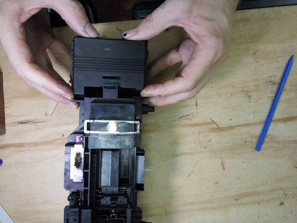 Undo the 4 screws on top, release the clip on the rear of the station, and lift off the top cover.