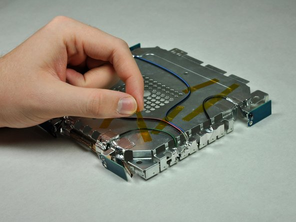 Remove the tape that attaches the wire to the logic board.