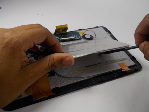 A small amount of heat may be required to safely remove the battery from the adhesive underneath. Use an iOpener or heat gun to soften the adhesive.