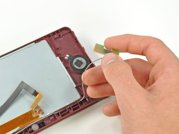 Lift the Wi-Fi antenna off the front display bezel.