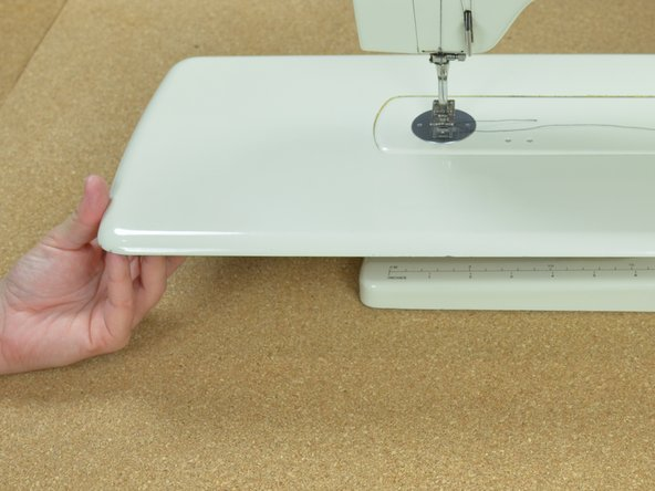 Hold the sewing machine table so that is lays flush with the sewing machine.