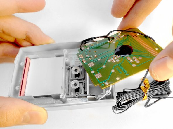 Lift the circuit board away from the case.