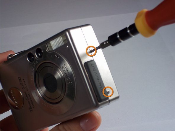 Remove two 2.4mm Phillips screws from the right side of the camera.