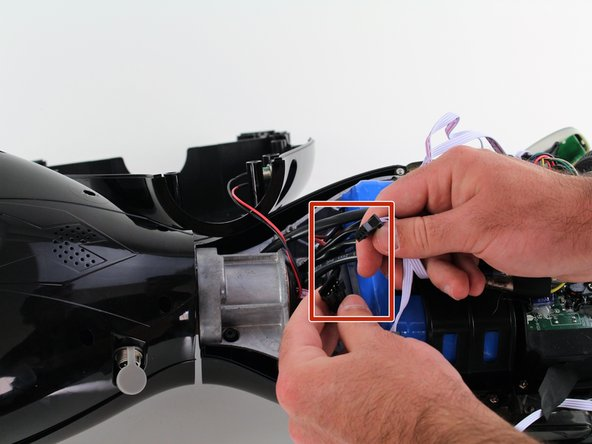 Unplug the lights from the battery by pulling gently on both sides of the black connector attached to the white wires.