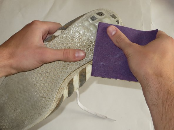 After 24 hours, use 150 grit sandpaper to rub down the surface of your filled hole to create a smooth surface.