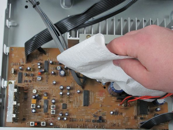 Carefully wipe the circuit board and its components to remove any dust.