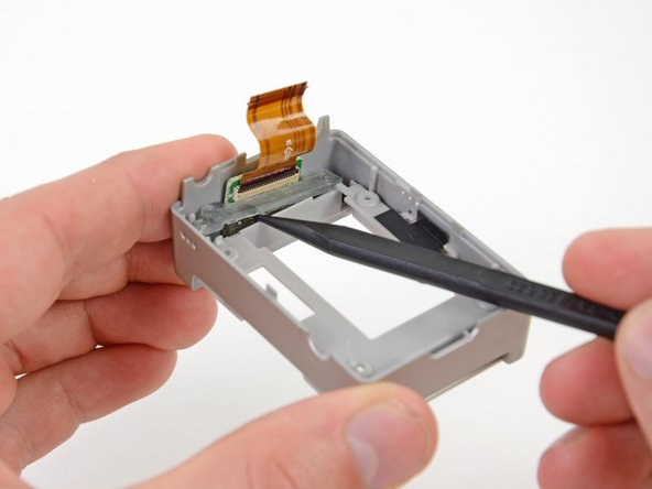 Use the tip of a spudger to push the bottom of the SD board cover up and out of the rear case.
