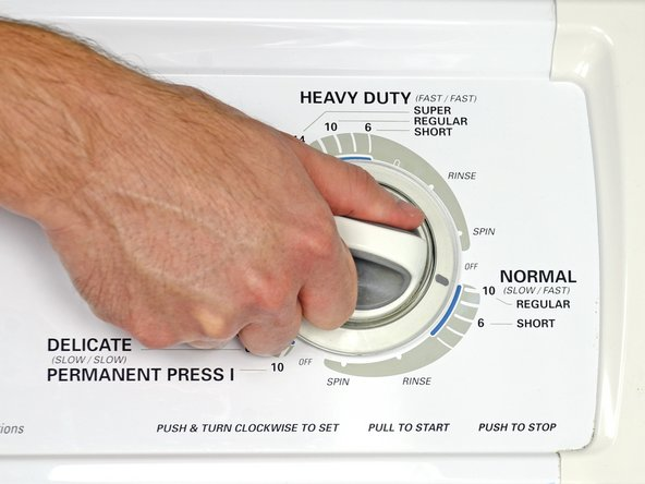 Run the washer on a regular or permanent press cycle setting.